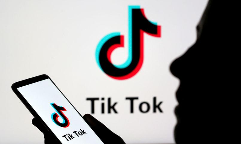 person using tiktok on mobile