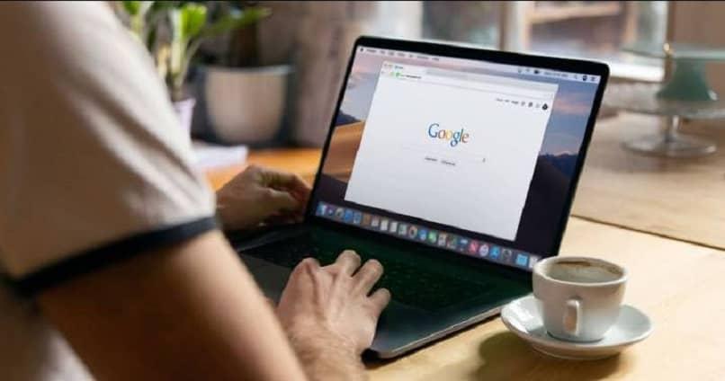 man using Google Chrome on his laptop