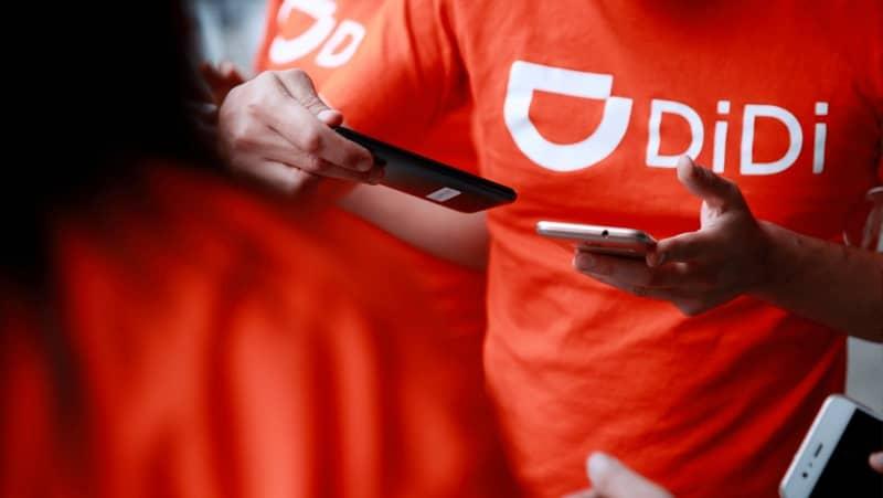 empleados uniforme didi naranja
